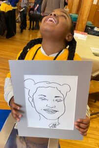 Braille Challenge Apprentice contestant smiling and holding up her tactile portrait