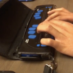 shows student's hands on a Focus 40 refreshable braille display